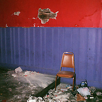 Hole in wall chair and trash
