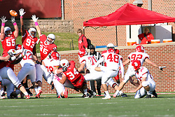 15 October 2011: Kevin Robb gets a field goal past Eric Brunner, Shelby Harris, and Colton Underwood during an NCAA football game between the University of South Dakota Coyotes and the Illinois State Redbirds (ISU) at Hancock Stadium in Normal Illinois.