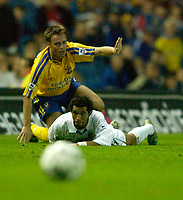 Photo. Jed Wee<br /> Leeds United v Southampton, FA Barclaycard Premiership, Elland Road, Leeds. 26/08/2003.<br /> Leeds' new signing Jermaine Pennant (R) is felled by Southampton's Graeme Le Saux who pleads his innocence.