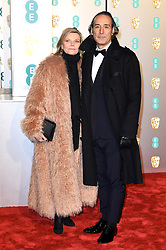Alexandra Desplat and Dominique Lemonnier attending the 72nd British Academy Film Awards held at the Royal Albert Hall, Kensington Gore, Kensington, London