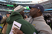 Dec 24, 2017; East Rutherford, NJ, USA; New York Jets head coach Todd Bowles (left) and Los Angeles Chargers head coach Anthony Lynn shake hands after an NFL football game at MetLife Stadium. The Chargers defeated the Jets 14-7.