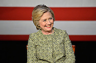 Port Washington, New York, USA. 11th April 2016. HILLARY CLINTON, leading Democratic presidential primary candidate, has a discussion on gun violence prevention with Rep. S. Israel, and with activists who lost family members due to shootings. The activists shared their stories of personal loss, and Hillary Clinton, the former Secretary of State and U.S. Senator from New York, called for stronger gun legislation and vowed to take on the gun lobby NRA National Rifle Association. Clinton had several Long Island events scheduled this day, and New York presidential primary is April 19.