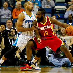 Jan 9, 2013; New Orleans, LA, USA; Houston Rockets shooting guard James Harden (13) works against New Orleans Hornets shooting guard Eric Gordon (10) during the first quarter of a game at the New Orleans Arena. Mandatory Credit: Derick E. Hingle-USA TODAY Sports