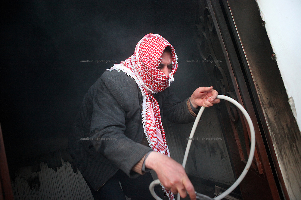 Villagers try to extingush a fire in a house. On 22. February the syrian army attacked the village of Kureen, Province of Idlib, Syria. Kureen was among the first villages in the northwest of Syria controlled by the opposition. Some villagers and members of the defence units escaped to surrounding olive orchards, when the attack begun in the early morning. A majority of the inhabitants didn´t manage to escape. The heavy shelling lasts 7 houres. Soldiers searched all houses, burnt some of them down, loote shops, stole cars and furniture. About 60 motorcycles were burnt down. Tanks demolished several houses. 6 men were executed. One woman died as a result of an heart attack.