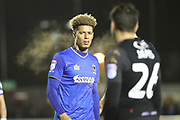 AFC Wimbledon striker Lyle Taylor (33) not happy with a decision during the EFL Sky Bet League 1 match between AFC Wimbledon and Wigan Athletic at the Cherry Red Records Stadium, Kingston, England on 16 December 2017. Photo by Matthew Redman.