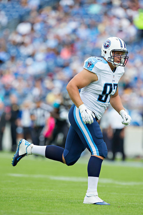 NASHVILLE, TN - OCTOBER 12:  Karl Klug #97 of the Tennessee Titans during a play against the Jacksonville Jaguars at LP Field on October 12, 2014 in Nashville, Tennessee.  The Titans defeated the Jaguars 16-14.  (Photo by Wesley Hitt/Getty Images) *** Local Caption *** Karl Klug