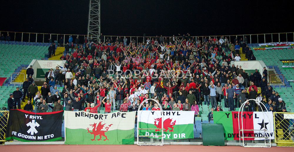 SOFIA, BULGARIA - Tuesday, October 11, 2011: Wales supporters celebrate their side's 1-0 victory over Bulgaria during the UEFA Euro 2012 Qualifying Group G match at the Vasil Levski National Stadium. (Pic by David Rawcliffe/Propaganda)