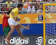 Football-FIFA Beach Soccer World Cup 2006 - Semi-final -BRA_POR -Bruno-BRA- header  next to Portugal's goal wathched by Hernani-POR - Rio de Janeiro - Brazil 11/11/2006<br />Mandatory credit: FIFA/ Marco Antonio Rezende.
