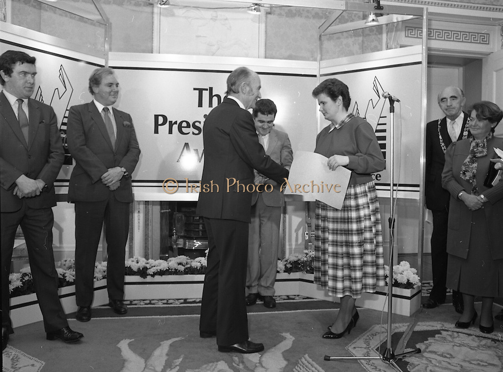 28/10/1985<br /> 10/28/1985<br /> 28 October 1985<br /> Launch of Gaisce The Presidents Award at Aras an Uachtarain. President Dr. Patrick Hillery launched the new national youth award scheme to be the nations highest award to Irish young people aged 15-25. Picture shows Catriona McSkeane, (left) presenting her pledge to President Hillery.  Dr. Tony O'Reilly is on the left.
