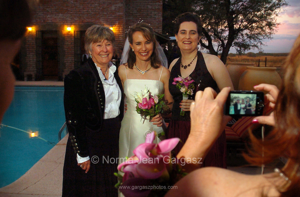 Arizona Congresswoman, Gabrielle Giffords, and her husband space shuttle commander, Mark Kelly, celebrated their wedding in Amado, Arizona, USA, on November 10, 2007.  Giffords mother, Gloria Kay Giffords, (left), and an unidentified woman join the bride for a photo op.