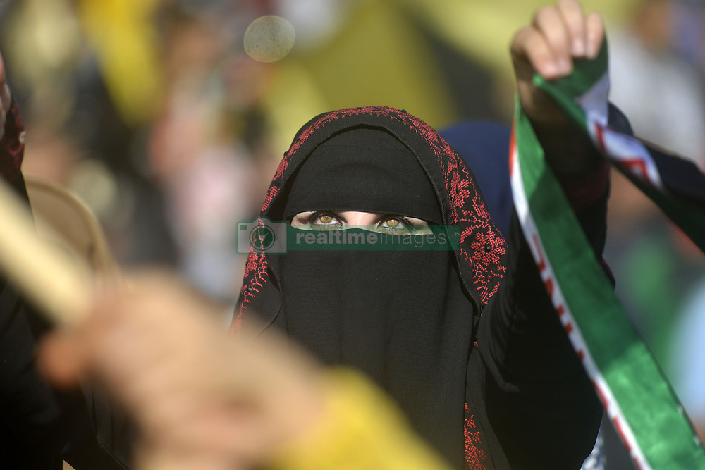 November 20, 2018 - Gaza, Palestinian Territories, Palestine - Supporters of exiled Palestinian politician and Fatah movement's former security chief, Mohammed Dahlan, hold images of late Palestinian leader Yasser Arafat during a commemoration ceremony held on the occasion of the 14th anniversary of Arafat's death, on November 20, 2018 in Gaza city. - Palestinians marked 14 years since the death of iconic leader, last week with their campaign for statehood still deadlocked and beset by internal divisions. Arafat, who for decades embodied the struggle for independence, died aged 75 in a French hospital on November 11, 2004, with fellow Palestinians accusing Israel of having poisoned him. (Credit Image: © Majdi Fathi/NurPhoto via ZUMA Press)