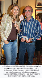 MISS SASKIA NIXDORF and LORD EDWARD MANNERS, at an exhibition in London on 29th June 2004.PWP 45