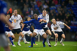 BOLTON, ENGLAND - Sunday, February 13, 2011: Everton's Victor Anichebe and Bolton Wanderers' David Wheater during the Premiership match at the Reebok Stadium. (Photo by David Rawcliffe/Propaganda)
