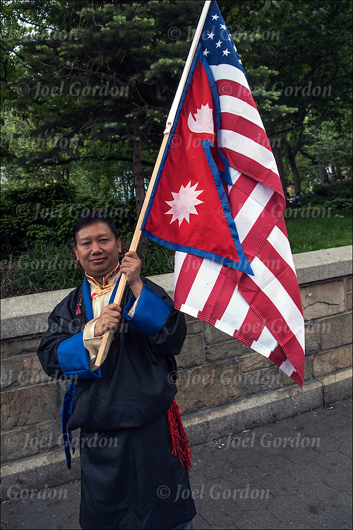 Portrait of Nepalese man holding Nepal and American flags in Union Square Park after the Nepal Day Parade.