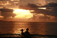 couple in hot tub at sunset at Marina Beach Hotel,  Sosua Beach, Dominican Republic..Photo by Owen Franken.