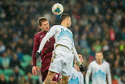 LJUBLJANA, SLOVENIA - NOVEMBER 16:  Kaspars Dubra  of Latvia and Haris Vuckic  of Slovenia jumping for a ball during the UEFA Euro 2020 Qualifier between Slovenia and Latvia on November 16, 2019 in Ljubljana, Slovenia. Photo by Vid Ponikvar / Sportida