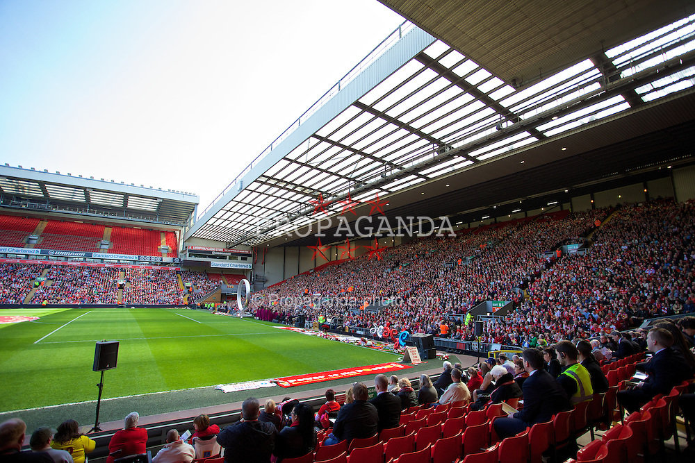 LIVERPOOL, ENGLAND - Tuesday, April 15, 2014: Liverpool supporters during the 25th Anniversary Hillsborough Service at Anfield. (Pic by David Rawcliffe/Propaganda)