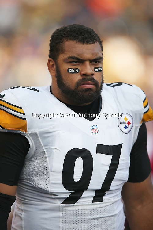 """Pittsburgh Steelers defensive end Cameron Heyward (97) looks on from the sideline wearing eye black tape printed with """"Iron Head"""" in honor of his late father, former NFL running back Craig """"Ironhead"""" Heyward who died of brain cancer, during the 2015 NFL week 5 regular season football game against the San Diego Chargers on Monday, Oct. 12, 2015 in San Diego. The Steelers won the game 24-20. (©Paul Anthony Spinelli)"""