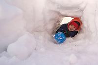playing in snow fort/snow cave