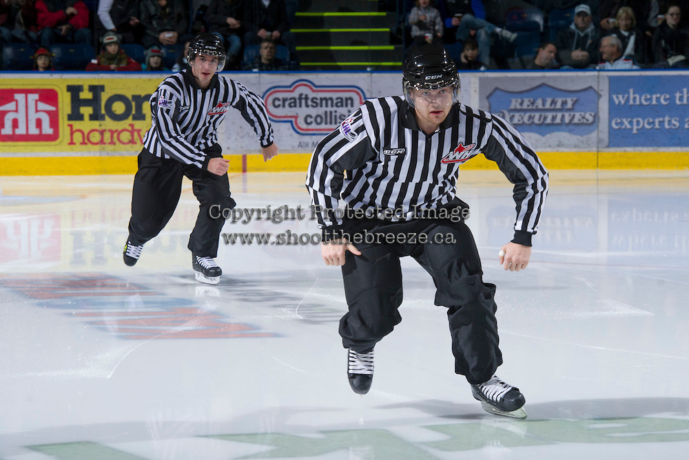 KELOWNA, CANADA - DECEMBER 8:  Alex Teichroeb and Mike Langin, linesmen, enter the ice as the Prince George Cougars visit the Kelowna Rockets on December 8, 2012 at Prospera Place in Kelowna, British Columbia, Canada (Photo by Marissa Baecker/Shoot the Breeze) *** Local Caption ***