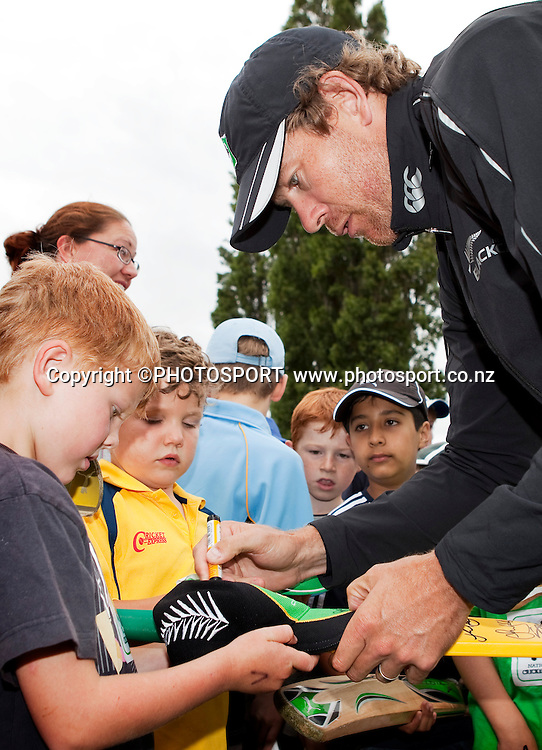 Jacob Oram signs autographs during the National Bank Super Camp, a National Bank initiative to connect with cricket's grass roots. Held at the East Shirley Cricket Club, Christchurch, New Zealand. Thursday, 27 January 2011. Joseph Johnson / PHOTOSPORT.
