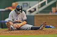New York Yankees base runner Brett Gardner reacts after getting tagged out trying to score at home plate during the second inning at Kauffman Stadium.