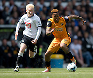 Abel Hernandez of Hull City (right) collects the ball as Will Hughes of Derby County tracks back during the Sky Bet Championship Playoff Semi Final First Leg at the iPro Stadium, Derby<br /> Picture by Russell Hart/Focus Images Ltd 07791 688 420<br /> 14/05/2016