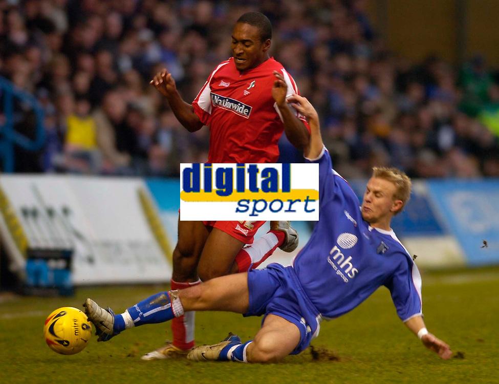 Photo: Alan Crowhurst.<br />Gillingham v Swindon Town. Coca Cola League 1. 14/01/2006. <br />Swindon's Ricky Shakes (L) and Danny Jackman challenge for the ball.