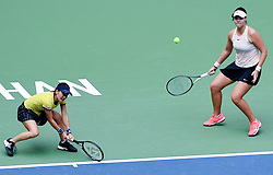 WUHAN, Sept. 28, 2018  Shuko Aoyama (L) of Japan and Lidziya Marozava of Belarus compete during the doubles semifinal match against Elise Mertens of Belgium and Demi Schuurs of the Netherlands at the 2018 WTA Wuhan Open tennis tournament in Wuhan, central China's Hubei Province, on Sept. 28, 2018. Elise Mertens and Demi Schuurs won 2-1. (Credit Image: © Song Zhenping/Xinhua via ZUMA Wire)