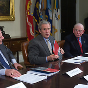 President Bush, center, flanked by Southwest Airlines Chairman Herb Kelleher, left, and retired Marine Gen. P.X. Kelley, co-chairman of the Energy Security Leadership Council, speaks to reporters during his meeting with members of Securing America's Future Energy (SAFE), a non-partisan organization aiming to reduce America's dependence on oil, Monday, Jan. 29, 2007 in the Roosevelt Room of the White House in Washington. <br /> <br /> Khue Bui for Newsweek
