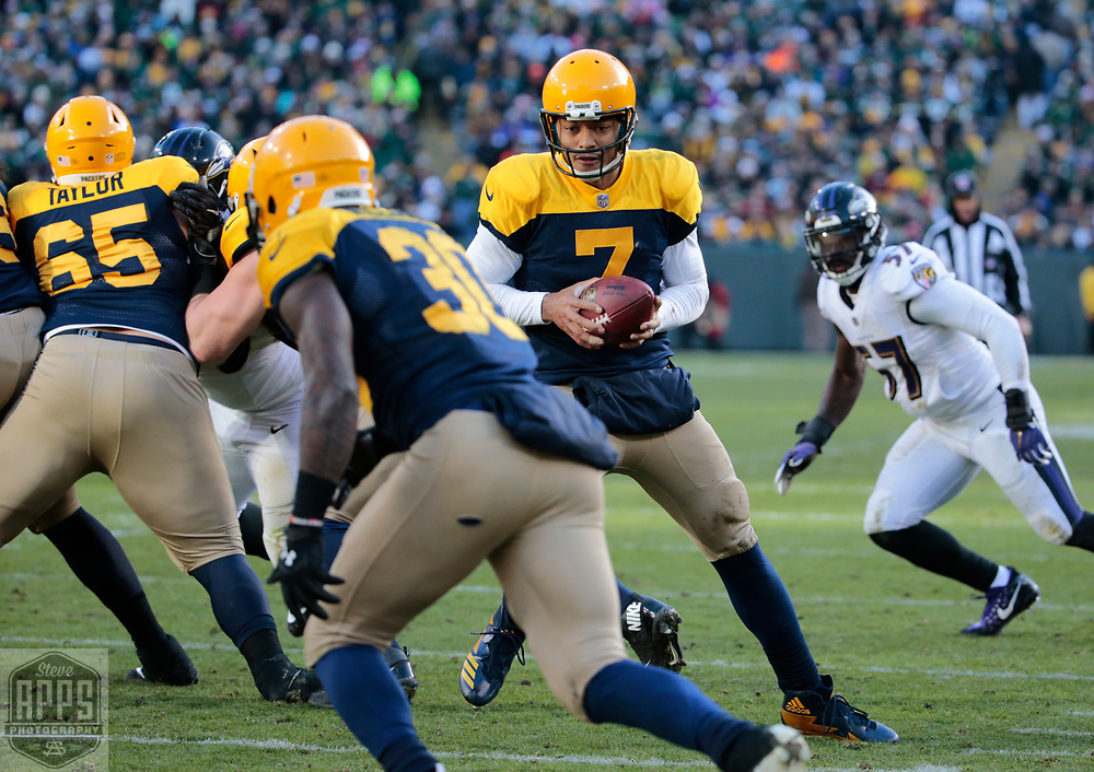 Green Bay Packers quarterback Brett Hundley (7) looking to handoff to Green Bay Packers running back Jamaal Williams (30) in the 4th quarter. <br /> The Green Bay Packers hosted the Baltimore Ravens at Lambeau Field Sunday, Nov. 19, 2017. The Packers lost 23-0. STEVE APPS FOR THE STATE JOURNAL.