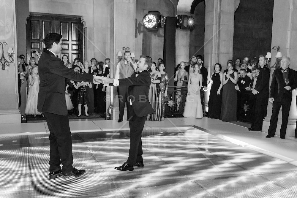 gay couple dancing at the reception on their wedding day