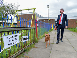 Scottish Labour leader Richard Leonard leaves his local polling station with his dog Copper after casting his vote in the European elections.<br /> <br /> © Dave Johnston / EEm