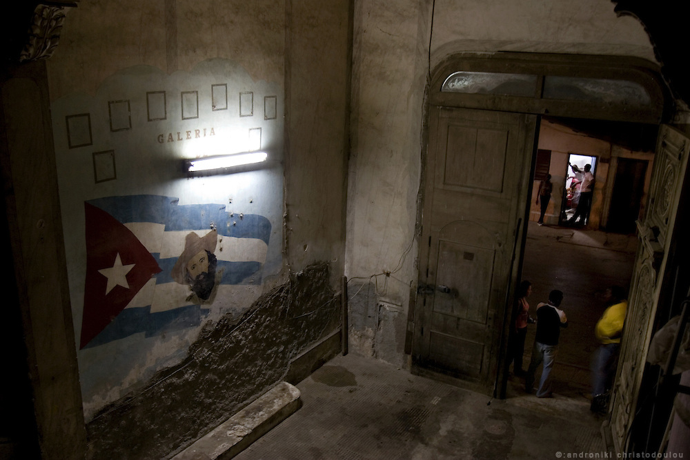 Graffiti with the picture of Cienfuegos on the Cuban flag, inside a colonial building in Havana - CUBA
