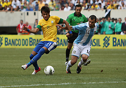 JUNE 09 2012:   Javier Mascherano (14) of Argentina tries to stop Neymar (11) of Brazil during an international friendly match at Metlife Stadium in East Rutherford,New Jersey. Argentina won 4-3.