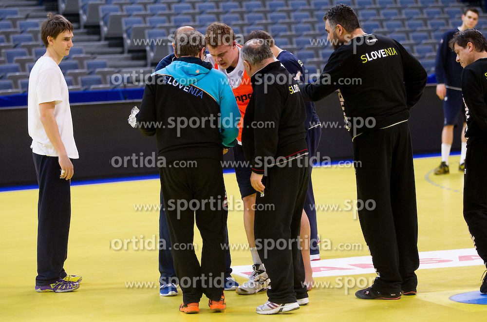Sebastian Skube of Slovenia, Gorazd Zuzek, Radivoj Stanic, Boris Denic, head coach of Slovenia with Matej Gaber of Slovenia (C) who has twisted his ankle during practice session of Slovenia team 1day before handball match against Macedonia for 5th place at 10th EHF European Handball Championship Serbia 2012, on January 26, 2012 in Beogradska Arena, Belgrade, Serbia.  (Photo By Vid Ponikvar / Sportida.com)