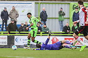 Forest Green Rovers Keanu Marsh-Brown(7) goes around Woking goalkeeper Michael Poke(1) during the Vanarama National League match between Forest Green Rovers and Woking at the New Lawn, Forest Green, United Kingdom on 25 February 2017. Photo by Shane Healey.