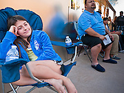14 OCTOBER 2011 - SCOTTSDALE, AZ:   HILLARY CLARK, 9, sits in a chair in front of the Apple Store in the Scottsdale Quarter before the iPhone 4S went on sale. Hillary was with her father, they arrived at the Apple Store at 9:30PM Thursday and spent the night camped with others who wanted to be the first to get their hands on the new iPhone. Hundreds of people lined up at the Apple Store in the Scottsdale Quarter in Scottsdale, AZ, Friday, Oct. 14, to buy the iPhone 4S. The phone sold out in pre-orders last week and sales at the Scottsdale Apple Store were brisk through the morning.  PHOTO BY JACK KURTZ