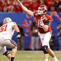 January 4, 2011; New Orleans, LA, USA;  Arkansas Razorbacks quarterback Ryan Mallett (15) throws against the Ohio State Buckeyes during the fourth quarter of the 2011 Sugar Bowl at the Louisiana Superdome.Ohio State defeated Arkansas 31-26. Mandatory Credit: Derick E. Hingle