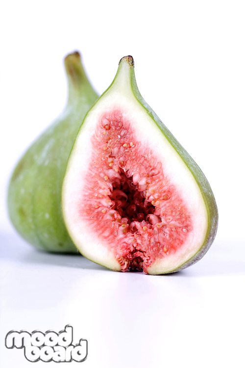 Close-up of figs on white background