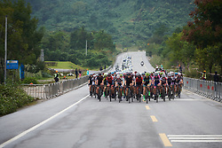 The peloton along big, wide roads at GREE Tour of Guangxi Women's World Tour 2018, a 145.8 km road race in Guilin, China on October 21, 2018. Photo by Sean Robinson/velofocus.com