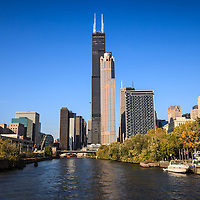 Photo of Chicago River with Willis Tower (Sears Tower). Willis Tower is one of the worlds tallest buildings and is a very popular attraction in Chicago.