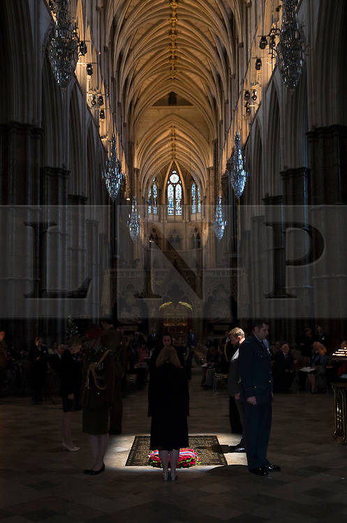 © Licensed to London News Pictures. 30/06/2016. London, UK. A vigil is held by military and civilian personnel at The Grave of the Unknown Warrior after The Battle of the Somme Centenary Service and at Westminster Abbey. An overnight vigil has started tonight and will end at 0730 tomorrow morning. Photo credit: Peter Macdiarmid/LNP
