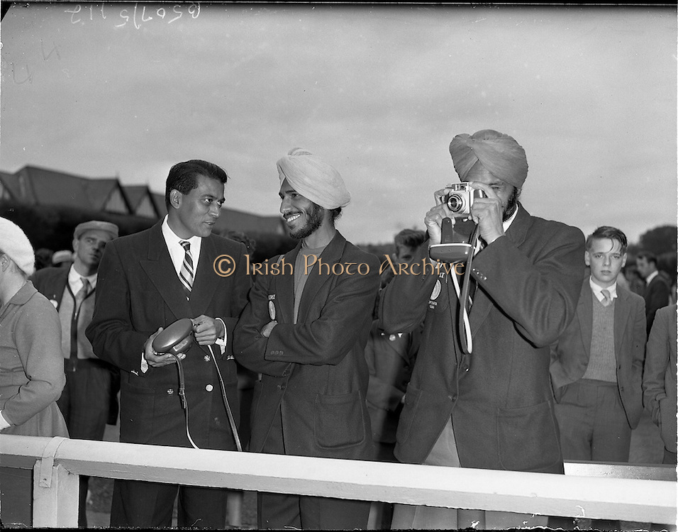 03/08/1960<br /> 08/03/1960<br /> 03 August 1960<br /> R.D.S Horse Show Dublin (Wednesday). Members of the Indian Olympic Team, who competed that night in Dublin, pictured relaxing at the Horse Show, (l-r); Virra Singh, (long-jumper); Milkah Singh, (100 metres) and team manager Commander Pereira.