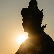 Silhouette of buddhist statue at sunset, Wat Saket, Bangkok