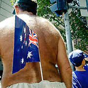 Fat man with Austrlian Flag in his short. People with Australian flags During Australia Day.
