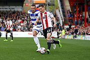 Brentford Sergi Canos (47) looks to get a cross in to the box during the EFL Sky Bet Championship match between Brentford and Queens Park Rangers at Griffin Park, London, England on 22 April 2017. Photo by Andy Walter.