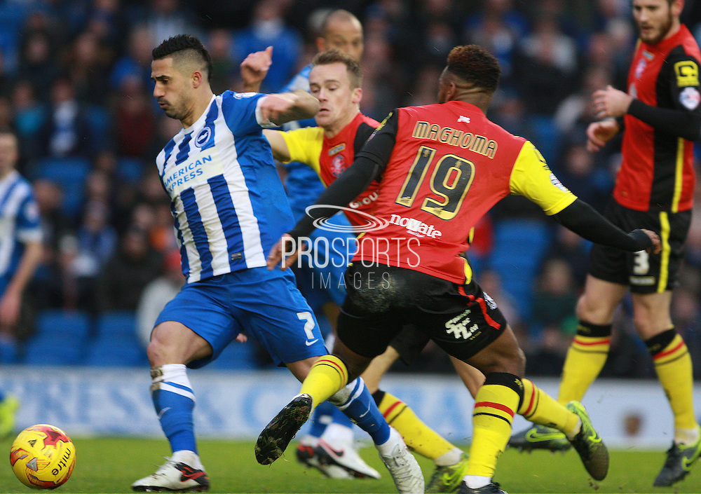 Brighton central midfielder Beram Kayal gets the better of Birmingham City midfielder Jacques Maghoma during the Sky Bet Championship match between Brighton and Hove Albion and Birmingham City at the American Express Community Stadium, Brighton and Hove, England on 28 November 2015. Photo by Bennett Dean.
