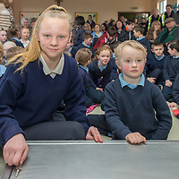 Eldest and youngest student from Kilfenora NS Aoibhin McCormack and Iarla Duffy lock the time capsule
