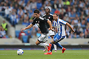 Brentford defender John Egan (14) and Brighton & Hove Albion centre forward Glenn Murray (17) during the EFL Sky Bet Championship match between Brighton and Hove Albion and Brentford at the American Express Community Stadium, Brighton and Hove, England on 10 September 2016.
